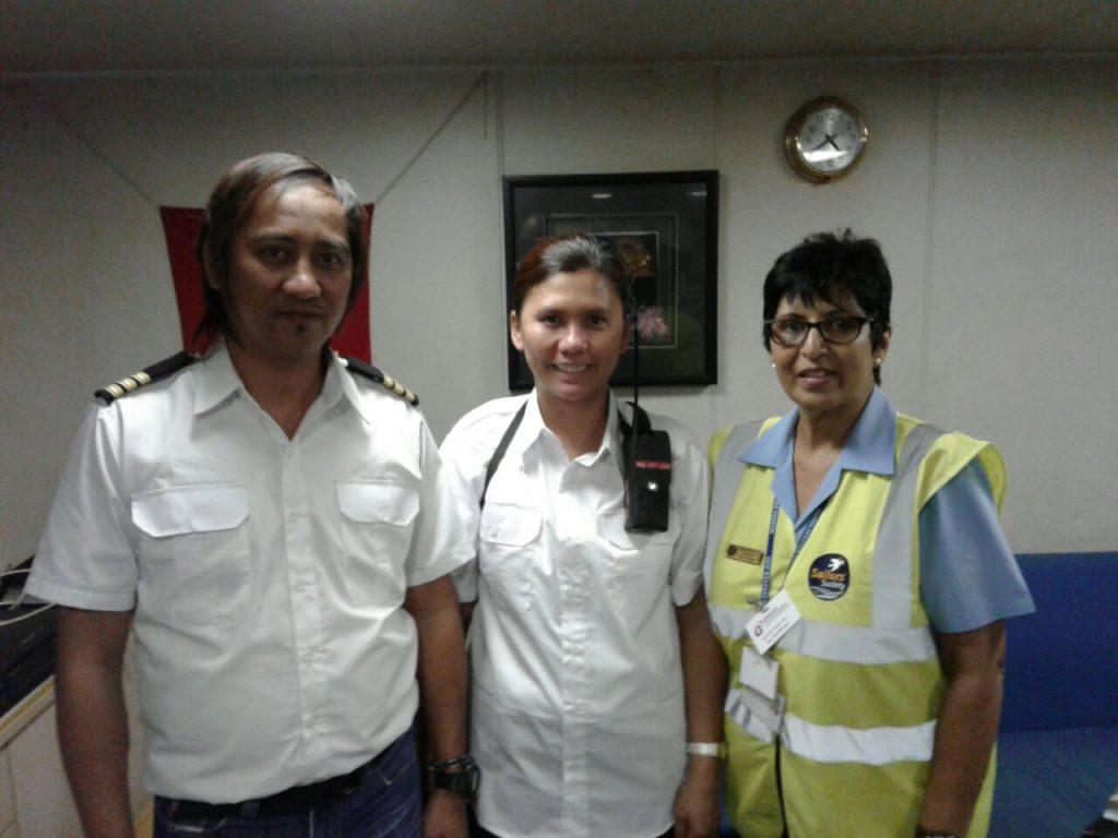Chaplain Jessie John [right] with 2 crew members
